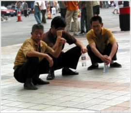 beijing-wangfujing-men-squatting-large-300x258
