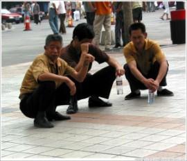 beijing-wangfujing-men-squatting-large-300x258